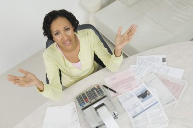 Woman With Documents And Expense Receipt