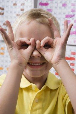 Boy Making Binoculars With His Hands