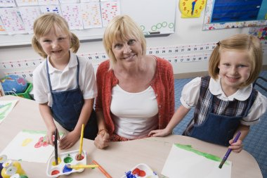 Teacher With Students In Art Class