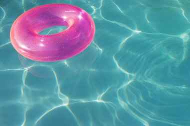 Pink Float Tube Floating On Water