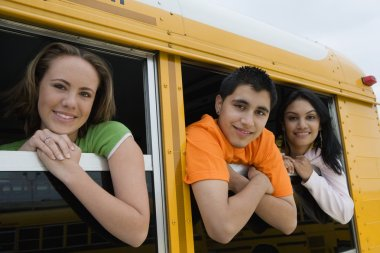 Students Looking Out Of School Bus Window