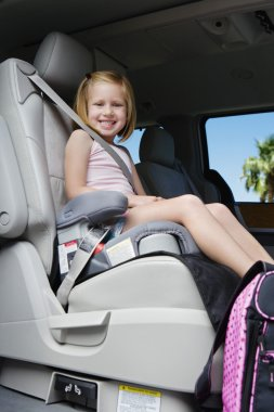 Girl Sitting In Booster Seat