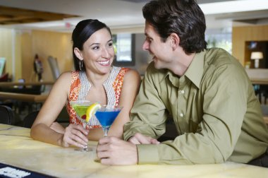 Couple With Martinis At Bar Counter