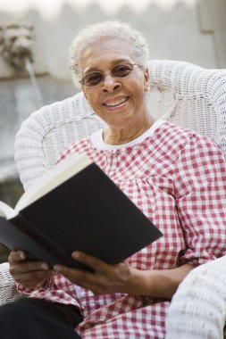 African american senior woman with book