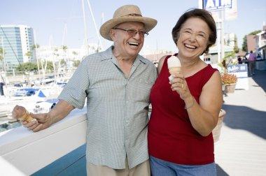 Cheerful Senior Caucasian Couple Holding Ice-creams