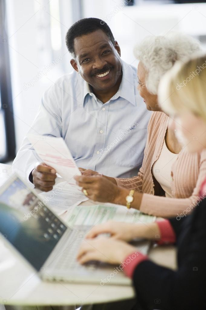 Couple With Female Financial Advisor