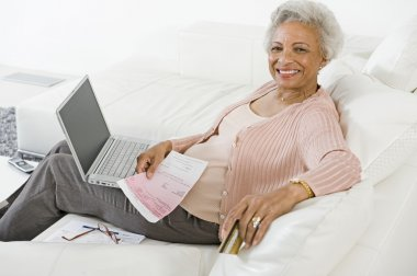 Senior Woman Paying Bills Online