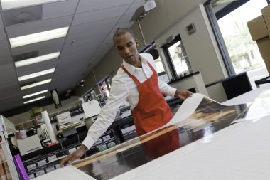 Manual worker taking printouts