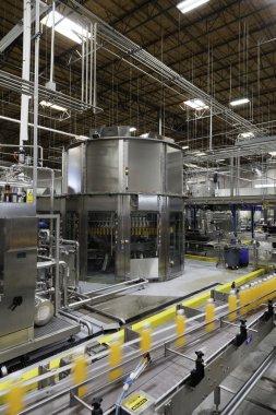Bottles on production line at bottling plant