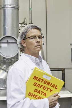 Middle-aged man on  factory