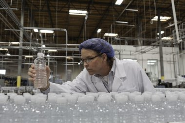 Quality control worker at bottling plant