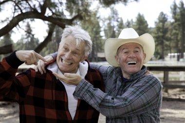 happy male senior cowboys