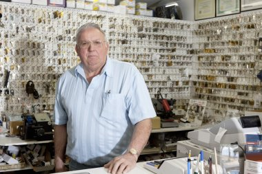 Senior locksmith  in hardware store