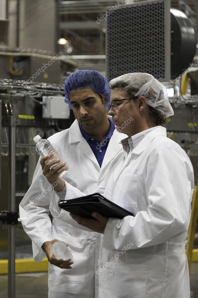 Factory workers with bottled water
