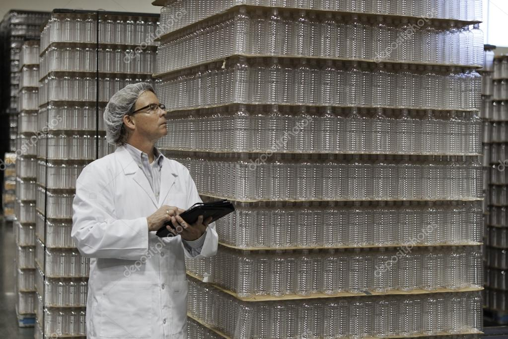 Man inspecting bottled water