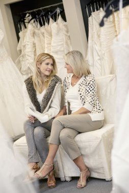 mother and daughter in bridal boutique