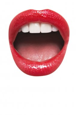Close-up view of female wearing red lipstick with mouth open over white background