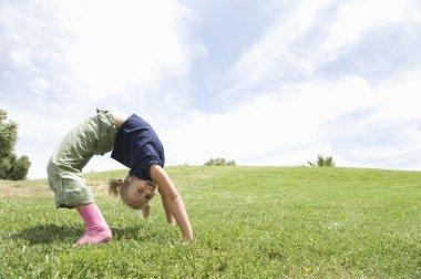 Girl Bending Over Backwards On Grass