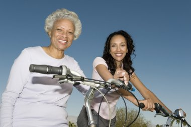 Mother And Daughter With Bicycles