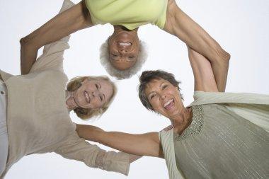 Senior Female Friends In A Huddle