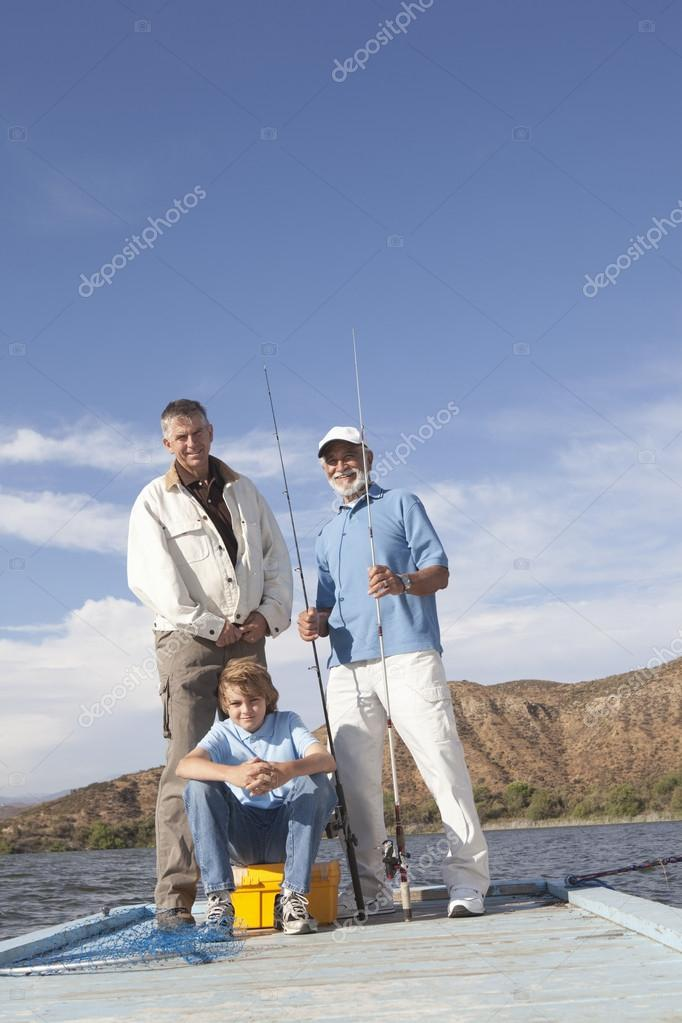 Father, Son And Grandson With Fishing Equipment