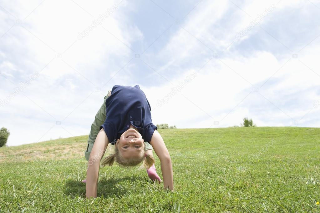 Girl Bending Over Backwards On Grass
