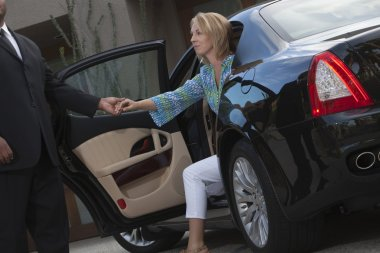 Chauffeur Helps Woman Get Down From Car