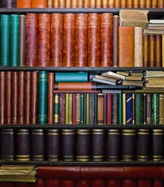 Rows of old books arranged in bookshelves stock vector