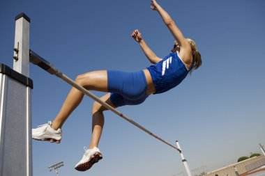 Athlete Performing High Jump