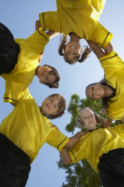 Soccer Team Forming Huddle
