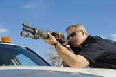 Photo Police Officer Aiming Shotgun