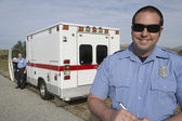 Photo Paramedic In Front Of Ambulance