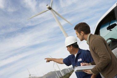 Engineers At Wind Farm