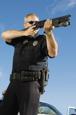 Police Officer Aiming Weapon