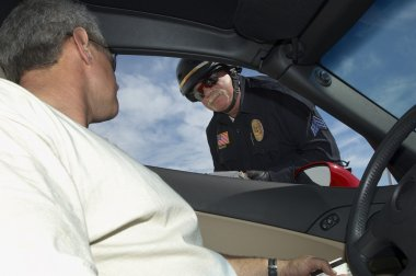Man In Discussion With Police Officer