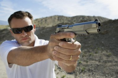 Man Aiming Hand Gun