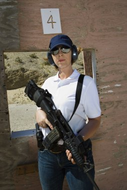 Woman Holding Machine Gun At Firing Range
