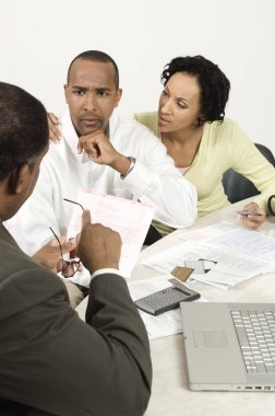An African American couple having discussion over an issue with financial advisor stock vector