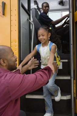 Father and daughter on school bus