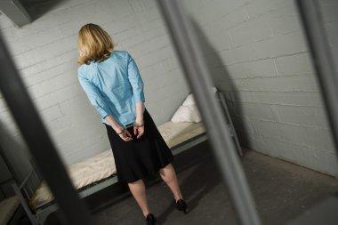 Handcuffed Criminal Behind Bars In Jail
