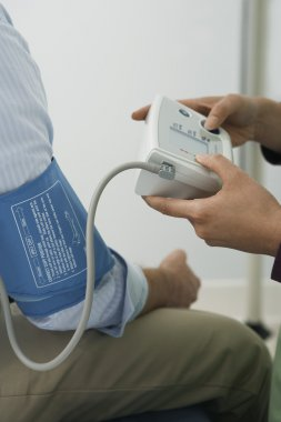 Doctor hands checking blood pressure