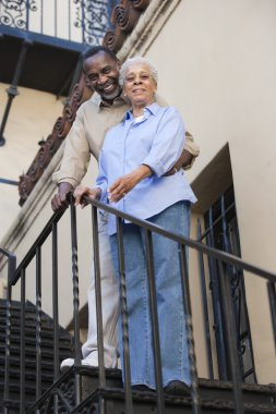 African American Couple Standing On Stairs