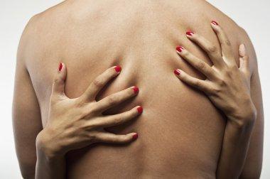 Woman's Hands Embracing Man's Torso