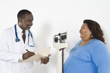 Doctor Examining Patient's Weight
