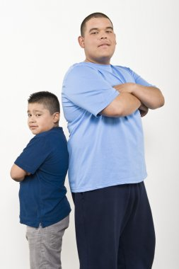Two Obese Brothers Standing Back To Back