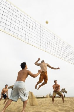 Man in Mid-air Going for Volleyball