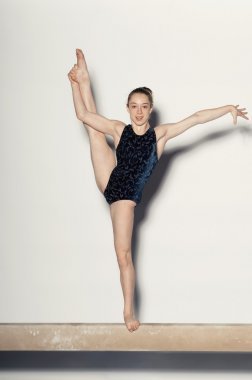 Teenaged Gymnast on Balance Beam