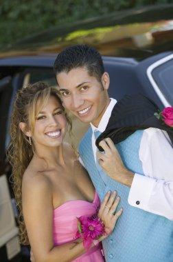 Well dressed teenage couple