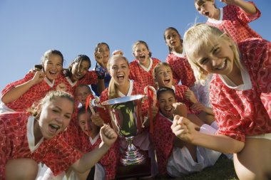 Victorious Soccer Team with Trophy