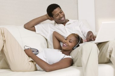 Couple Relaxing with CD player
